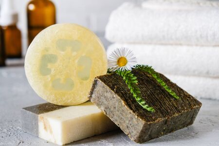 Natural cosmetic oil and natural handmade soap with loofah . Healthy skin care. SPA concept