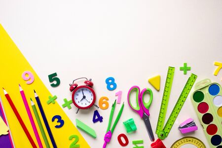 Back to school. Items for the school on a light background