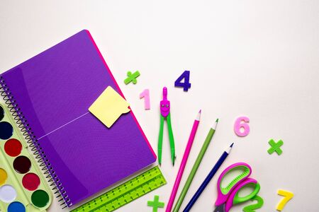 Office and student gear over light background - Back to school concept. Top view Zdjęcie Seryjne