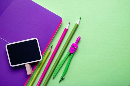 School supplies on light green background. Back to school concept