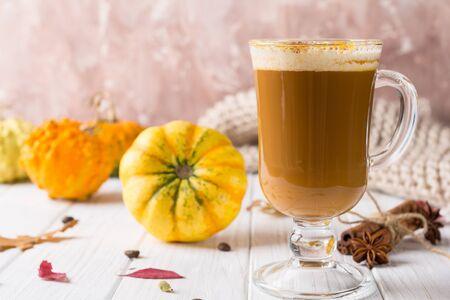 Pumpkins spice latte with pumpkins Copy space. Pumpkin latte - cozy drink for cold fall or winter Zdjęcie Seryjne