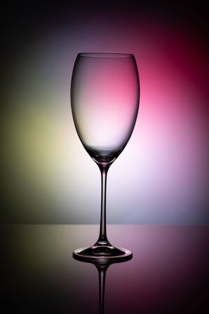 Empty wine glass goblets on a colored background abstract Stockfoto - 129800319