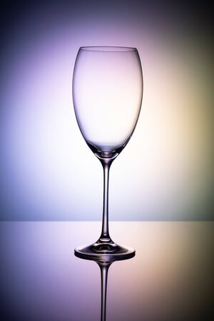 Empty wine glass goblets on a colored purple background abstract Stockfoto