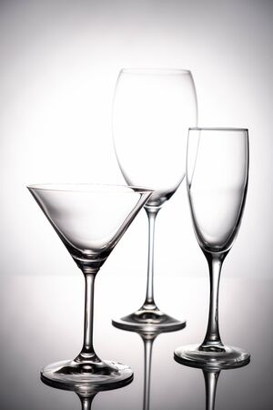 Empty glass goblets set. On a white background abstract Stockfoto - 129800330