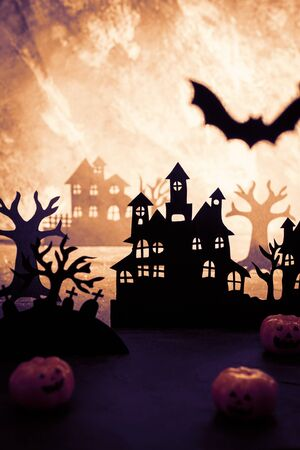 Mysterious night landscape with houses silhouettes and graveyard Template for design with space for text. Zdjęcie Seryjne