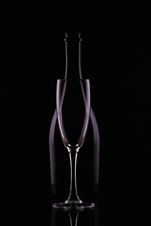 Abstract bottle champagne and glass shapes reflection on a black background