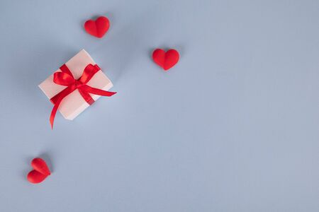 Valentines Day background. Gift box on blue background. Valentines day concept. Flat lay, top view, copy space