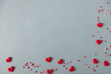 Valentines Day background. Red candy  hearts on pastel blue background. Valentines day concept. Flat lay, top view, copy space