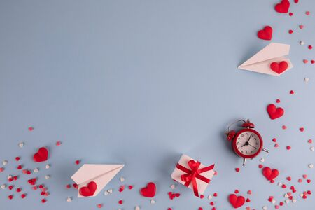 Valentines Day background. Gifts, confetti, paper plane on pastel blue background. Valentines day concept. Flat lay, top view, copy space Reklamní fotografie