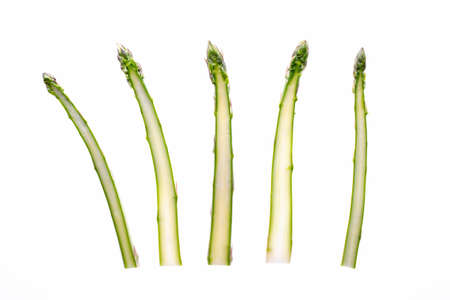 Asparagus slice. Bunch of fresh green asparagus isolated on white background.