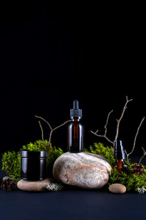 Cosmetic bottle on nature background. Natural eco friendly organic cosmetics concept. Фото со стока