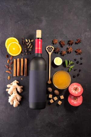 Ð¡hristmas or winter warming drink. .Mulled wine recipe ingredients on black chalkboard
