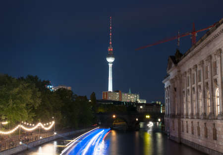 Night view on the TV Tower in Berlin and river Spree
