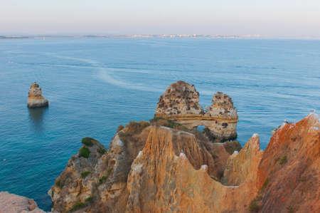 View on the orange rocks in the Atlantic ocean in Lagos, Portugal. photo