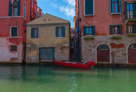 prow: Red gondola moored in Venice, Italy Europe. Stock Photo