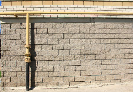 gas pipe: gas pipe on a brick wall