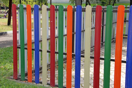 batten: fence with colored slats Stock Photo