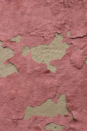 Peeled pink paint on plastered wall, background