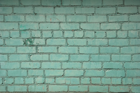 Painted old brick wall, green background