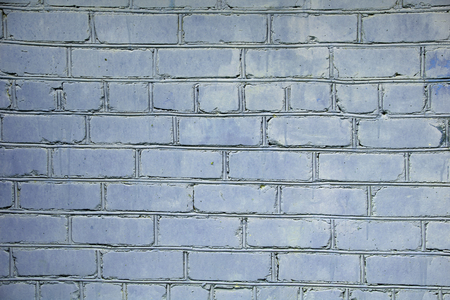 Painted old brick wall, blue background Stok Fotoğraf