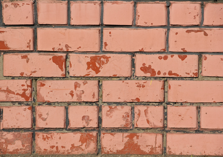 Old peeling red brick wall, background