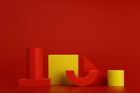 Abstract duotone composition with red and yellow geometric figures on red background with copy space