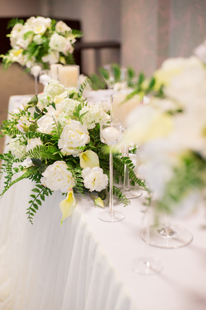 Wedding decor in the interior white flowers on the table serving stock photo wedding decor in the interior white flowers on the table serving the table with glasses mightylinksfo