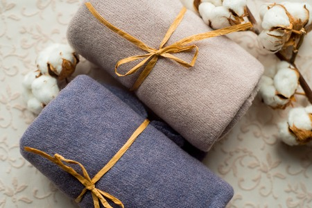 Home interior tailor sewing, diy concept. Heap of colorful cloth fabrics. Color Wool, cotton linen clothes. Stock Photo