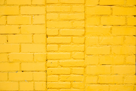 Bright Yellow brick wall background in rural room, Copy place for inscription