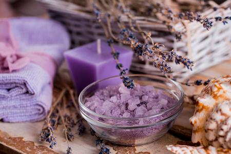 Spa massage setting, lavender product, oil on wooden background, Soap lavender flavored salt violet color