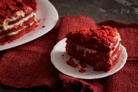 Red velvet cake on wood board, Canvas napkin on a concrete dark gray background