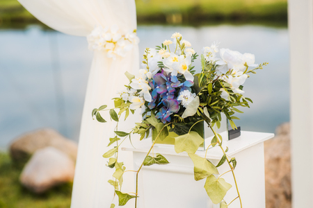 The wedding arch is decorated with blue flowers and white light stock photo the wedding arch is decorated with blue flowers and white light silk summer wedding ceremony bridal bouquet mightylinksfo