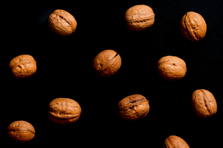 Walnuts isolated on black background, walnut as background on black background