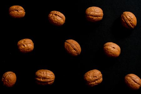 Walnuts isolated on black background, walnut as background on black background