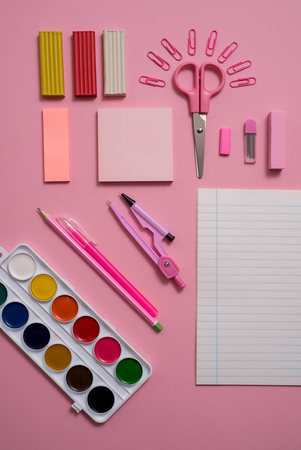 Stationary concept, Flat Lay top view Photo of Scissorsschool supplies, notepad and pens, color pencils, on a pink background. pink background with copy space. 写真素材