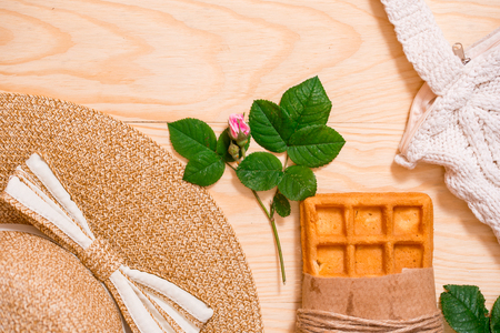 Minimal styled flat lay isolated on white background. Feminine desk top view with summer accessories: hat, croissant, coffee Summer holiday app presentation