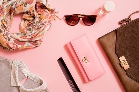 Fashion lady accessories set. Falt Lay. Stylish handbag. Make-Up brushes. Summer sunglasses. Jewelry and nail polish. Women accessories. Trendy fashion design.