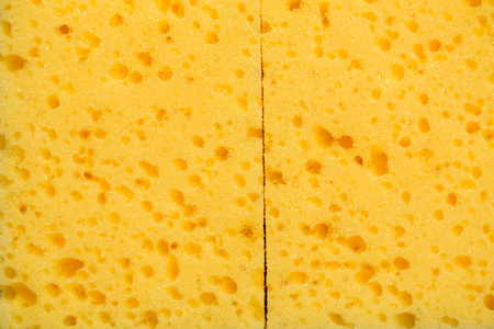 Yellow kitchen sponge on white background. dish sponge background