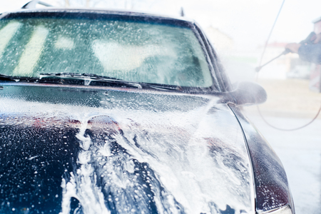 Car washing. Cleaning Car Using High Pressure Water. foam and pure water spray
