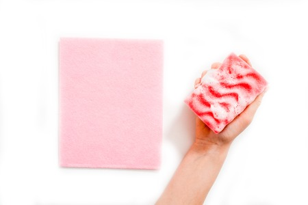 Womens hands wearing pink latex gloves for cleaning
