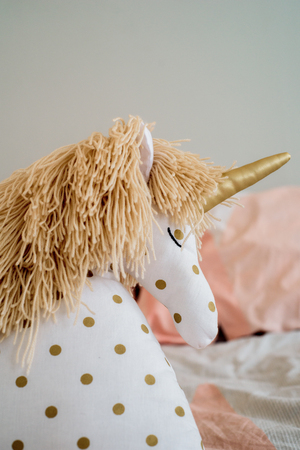 Childrens concept, a pillow unicorn on blood. childrens room. early morning with your favorite toy unicorn Stockfoto