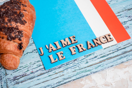 Fresh croissant with French flag on marble table background. Top view. Copy space Stockfoto