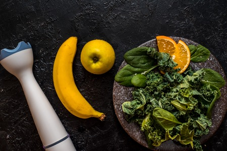 Apple banana spinach, kale, kiwi smoothie bowl . Dark food photography concept. Flatlay with copy space