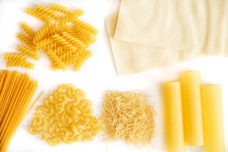cannelloni and lasagna, spaghetti and pasta raw on a white background. Cooking pasta. Italian food concept