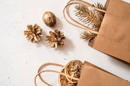 Mocap Christmas handmade gift craft pac on white background top view. Golden christmas balls and beads. Merry christmas greeting card. Winter xmas holiday theme. Happy New Year. Flat lay.copy space Banco de Imagens
