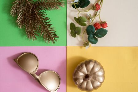 Creative season layout of summer, spring, autumn and winter leaves and flowers. Christmas fir tree, summer sunglasses, spring flowers,autumn golden pumpkin.four colors.Seasonal concept. Flat lay 写真素材 - 129216403