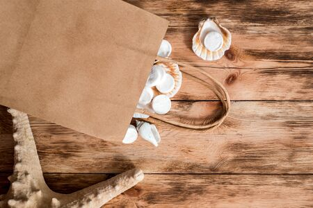 wooden background. fabric masks for the face. facial skin care. sea salt Beauty spa treatment and relax concept.