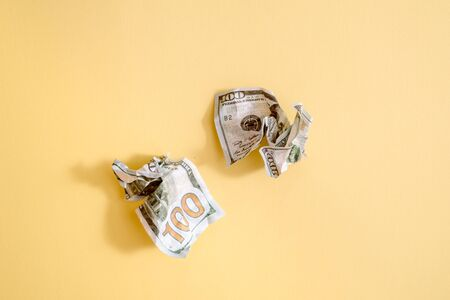 Crumpled dollars money On a yellow background. New age of cryptocurrency money concept. Flat lay copy space