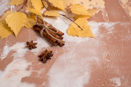 Dry autumn yellow birch leaves on a concrete background. Cozy autumn concept