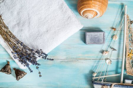 Sea spa, white towel, blue wooden old